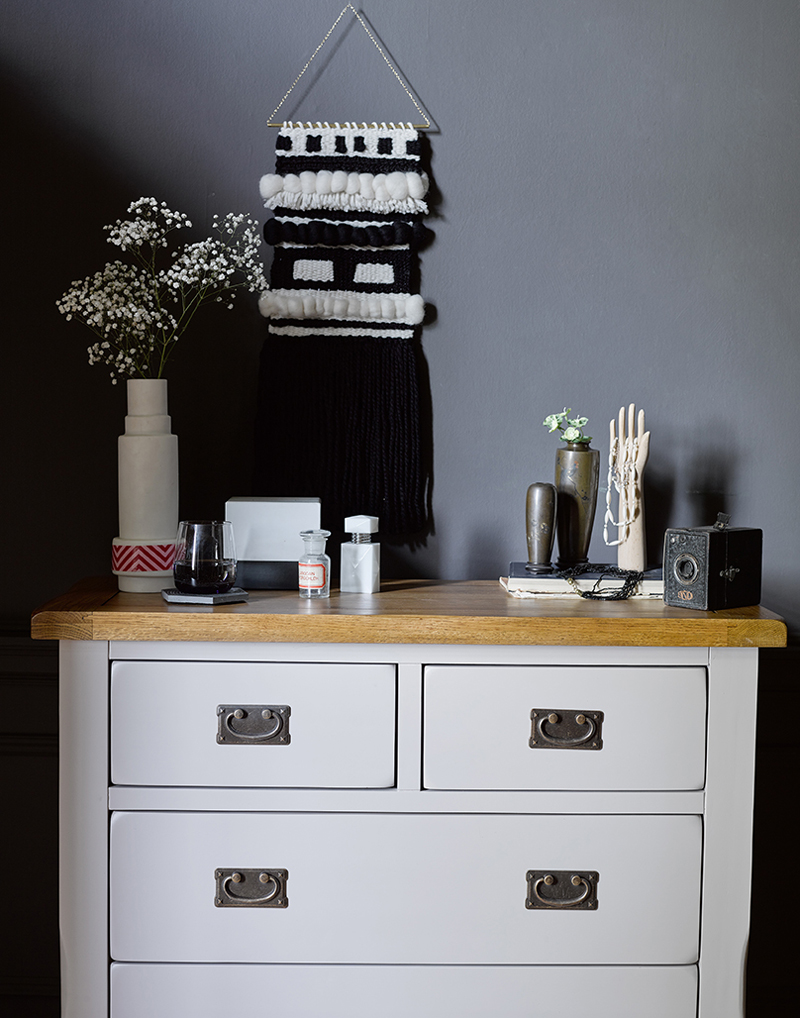 Grey painted chest of drawers with scandi accessories