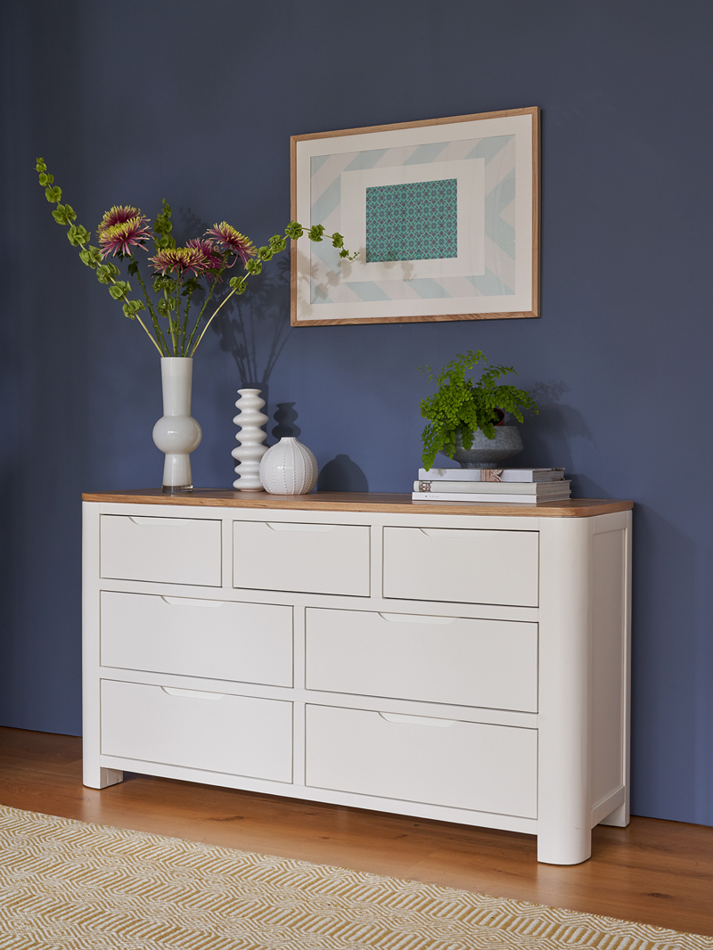 White chest of drawers with white accessories
