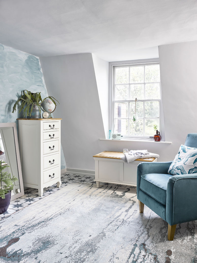 White painted tallboy in light washed bedroom