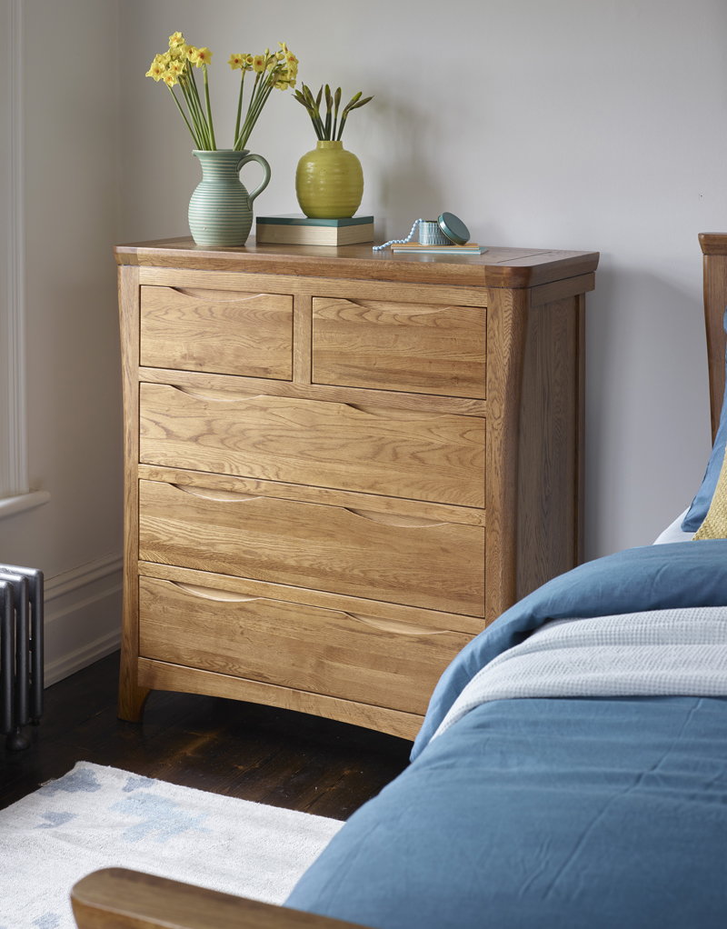 chest of drawers with curved edges