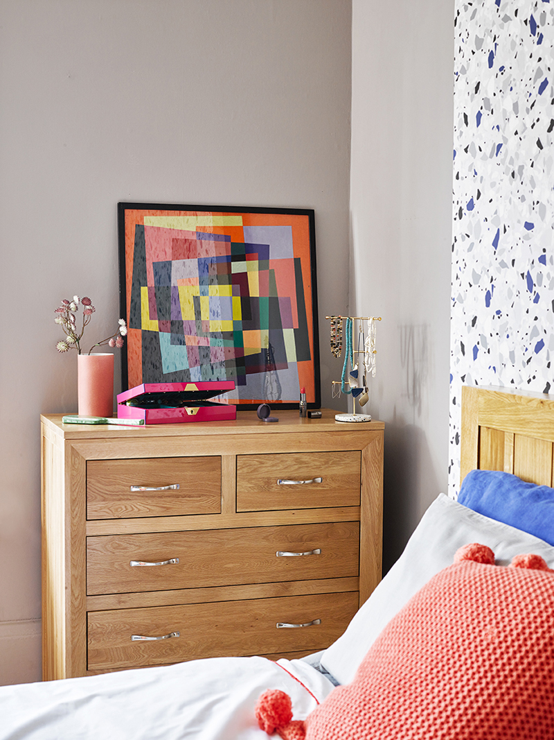 chest of drawers topped with colourful accessories