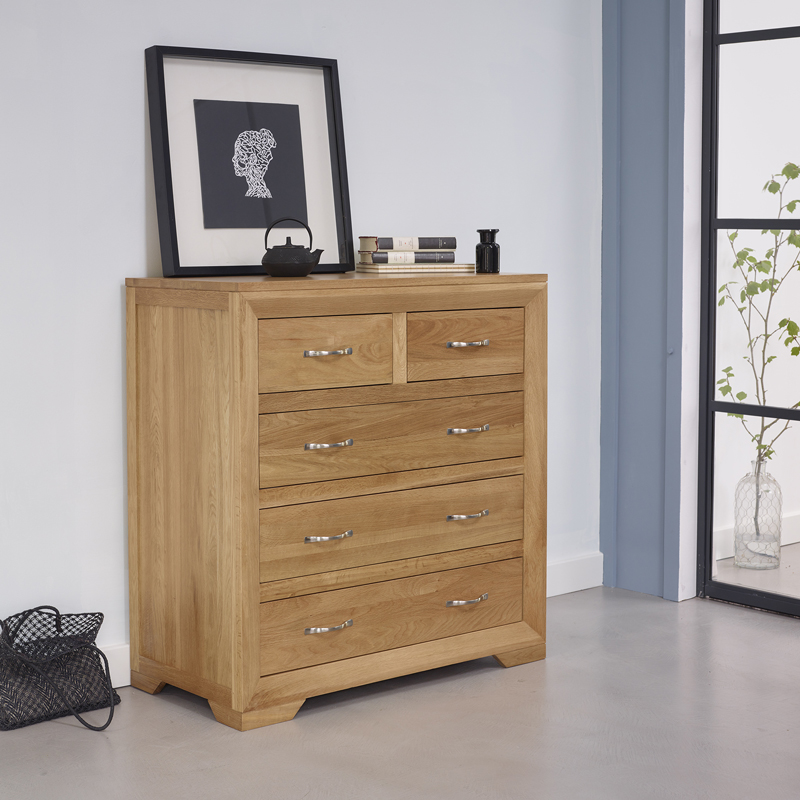chest of drawers in bedroom with photo frame on top