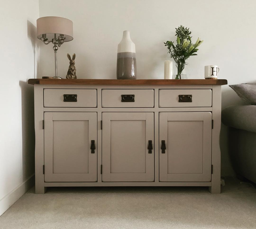 Grey painted sideboard with ornaments