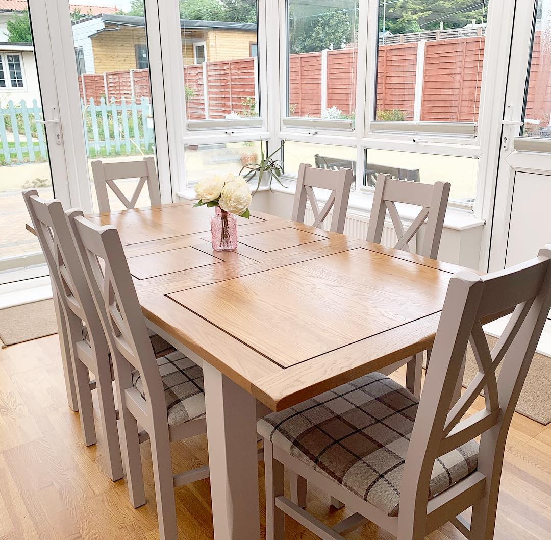 Grey painted dining table in bright conservatory