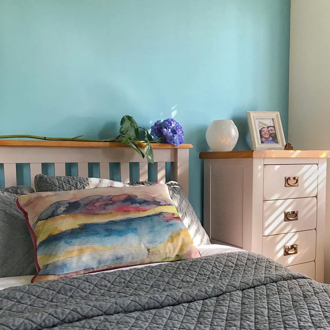 Grey painted bedroom furniture in turquoise bedroom