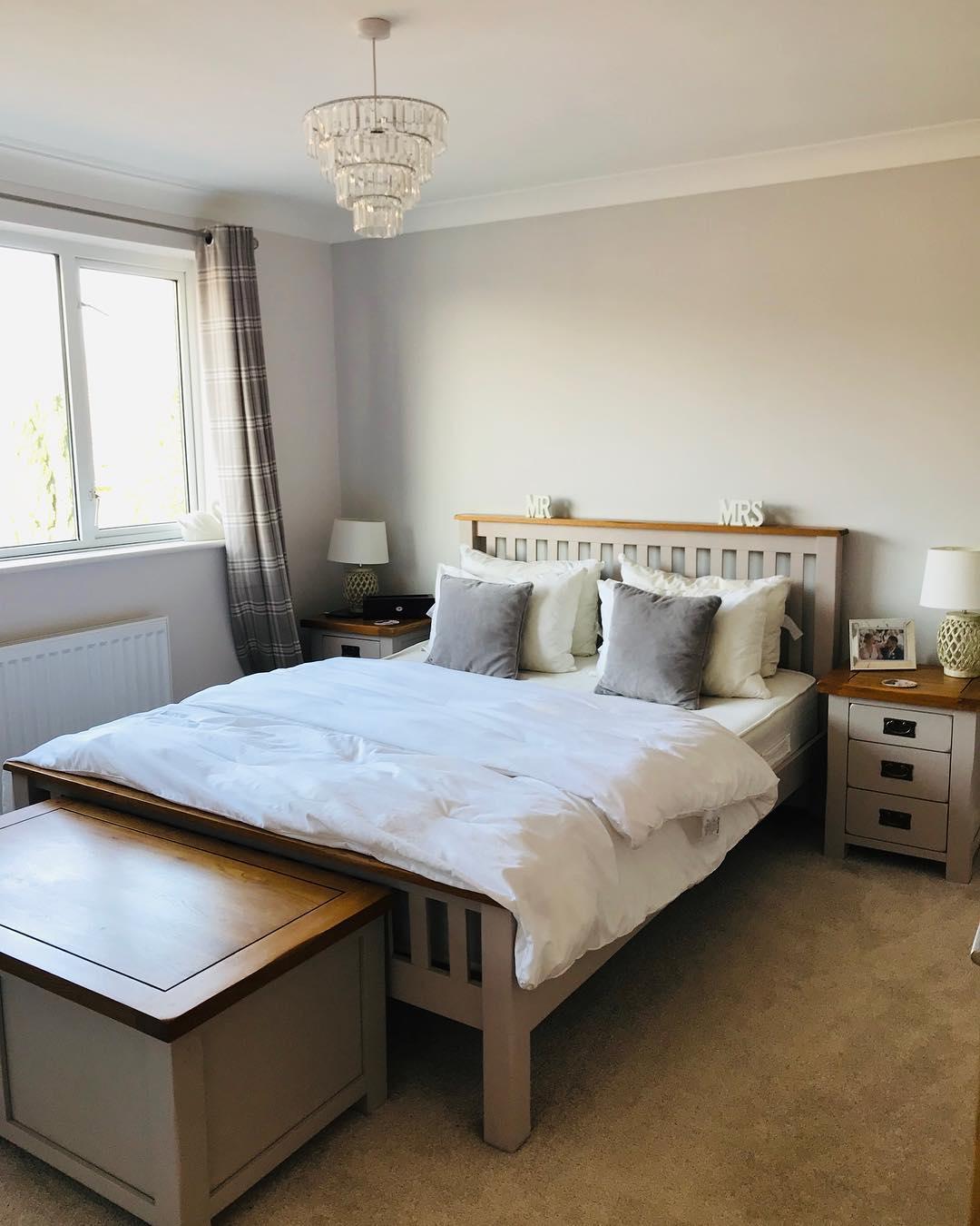 Grey painted kemble bedroom furniture in bright bedroom