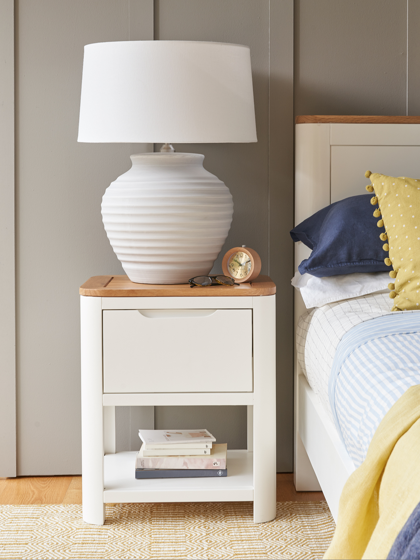 White modern bedside table with white lamp