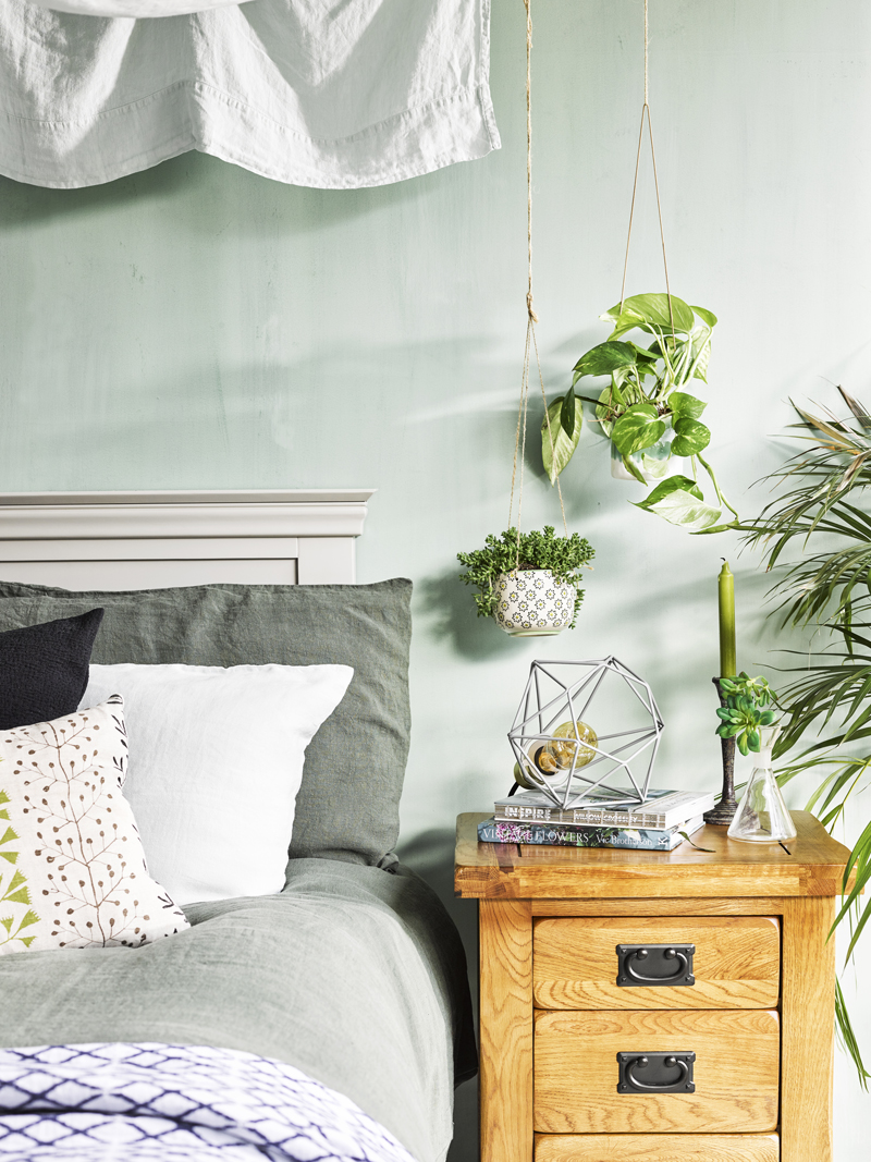 green calming bedroom with contrasting furniture