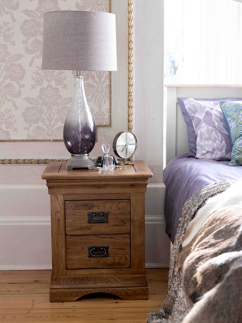 Bedside table with purple lamp