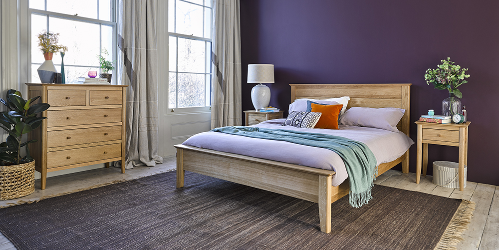 oak bedroom furniture in purple bedroom