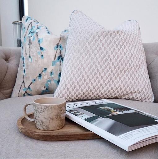 blush toned cushion wiith magazine