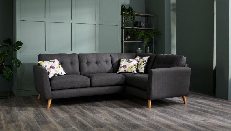 Charcoal grey corner sofa in green living room