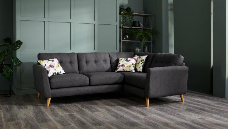 Charcoal grey corner sofa in green living room