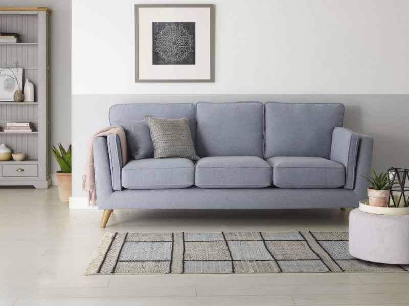 Blue Grey fabric sofa in neutral living area