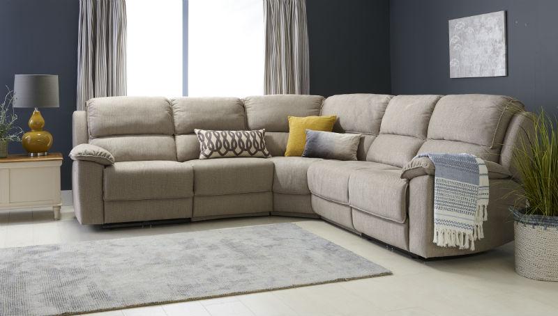 Beige suede reclining corner sofa in blue living room