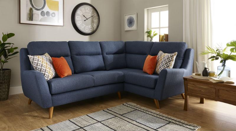 Dark Blue Corner sofa with contrasting cushions