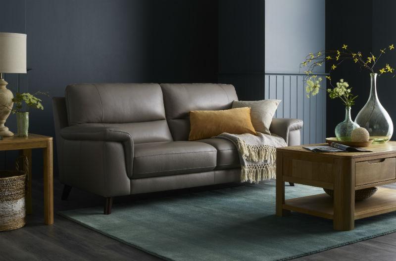 Grey-beige leather sofa in dark cosy living area