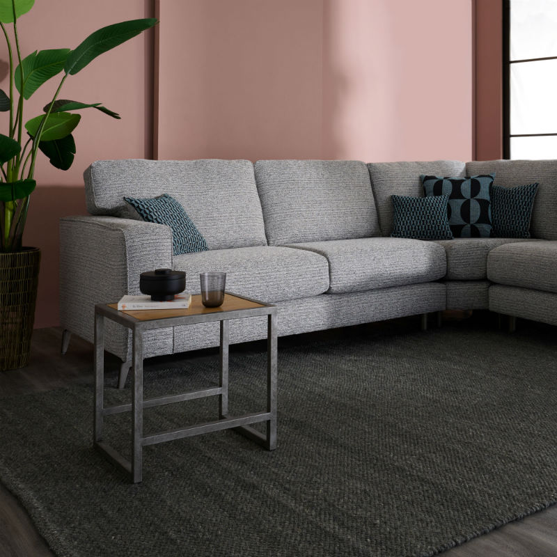 Grey fabric corner sofa with industrial coffee table