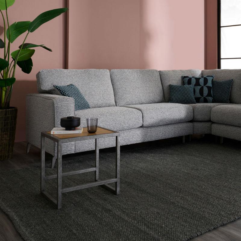 Grey fabric corner sofa with industrial coffee table