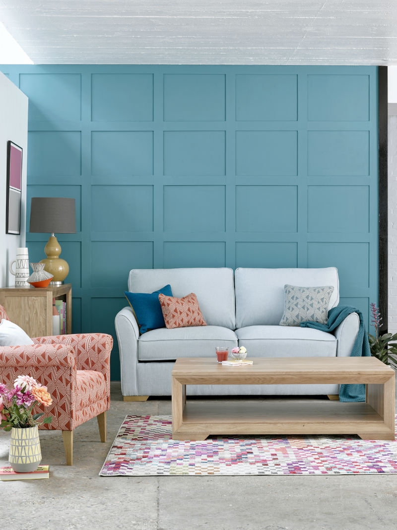 blue sofa with red geometric patterned accent chair