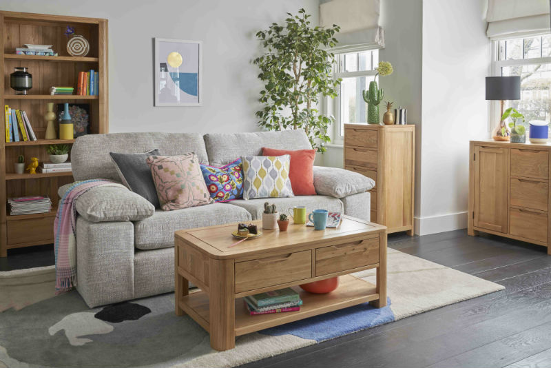 Bright living room with matching oak furniture and grey sofa