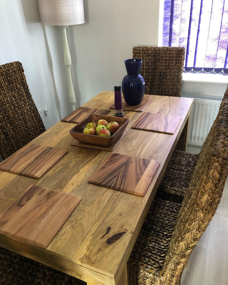 mango oak dining table with woven grass chairs