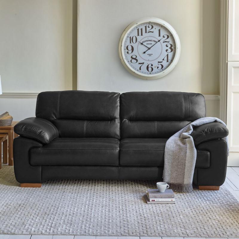 Black leather sofa in cream living room