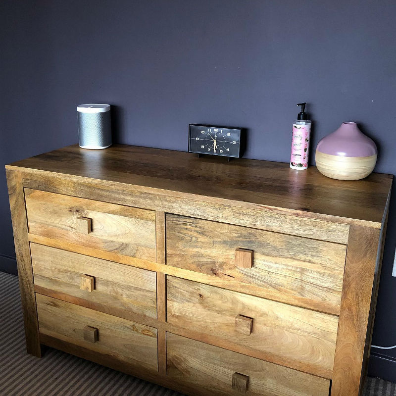 mango oak chest of drawers in purple bedroom