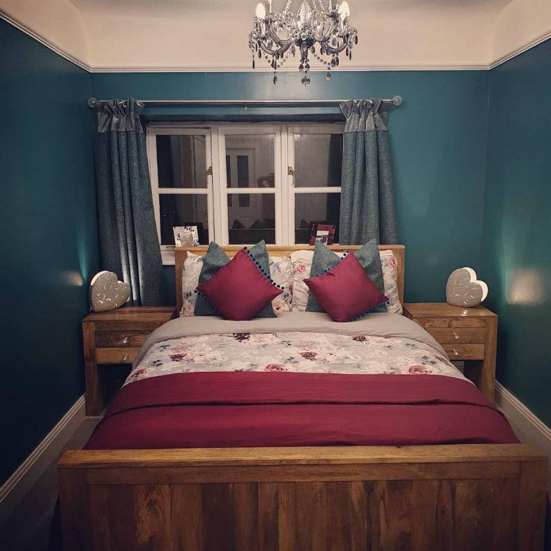 matching mango oak bedroom furniture in blue bedroom