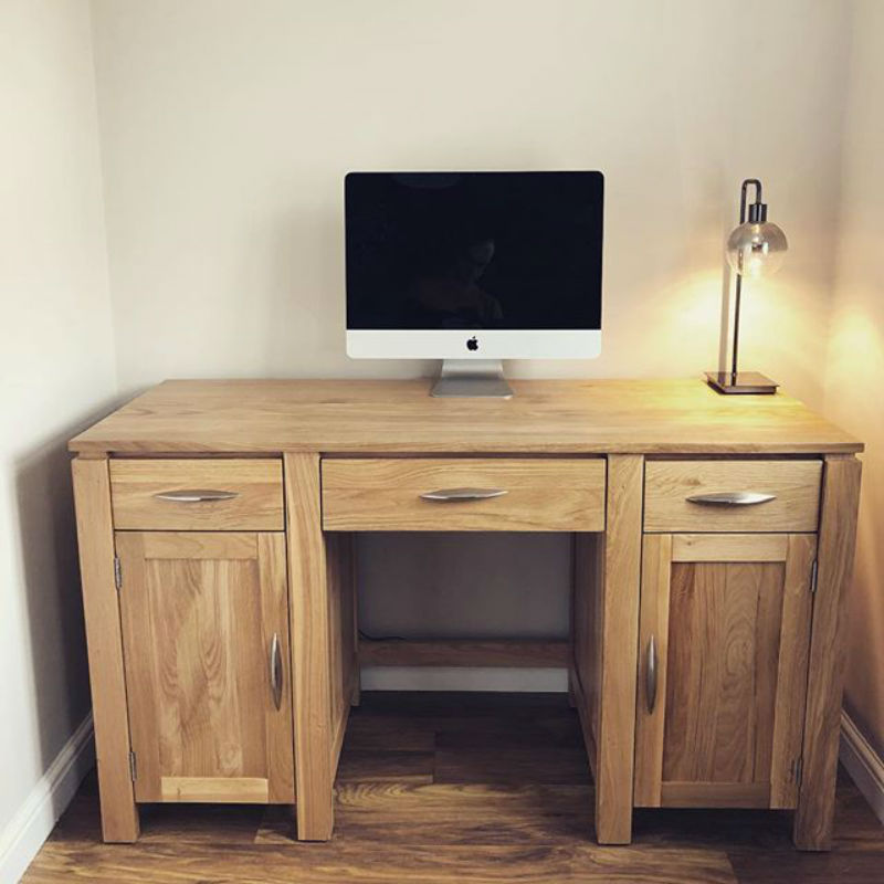 oak computer desk with apple mac and side lamp