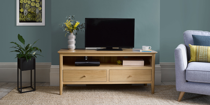 Scandi style oak tv stand in minimal living room