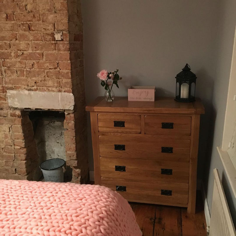oak chest of drawers in rustic style bedroom