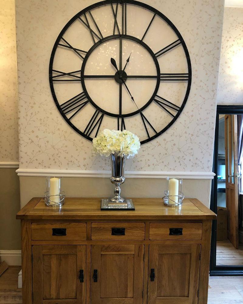 Oak sideboard with skeletal wall clock