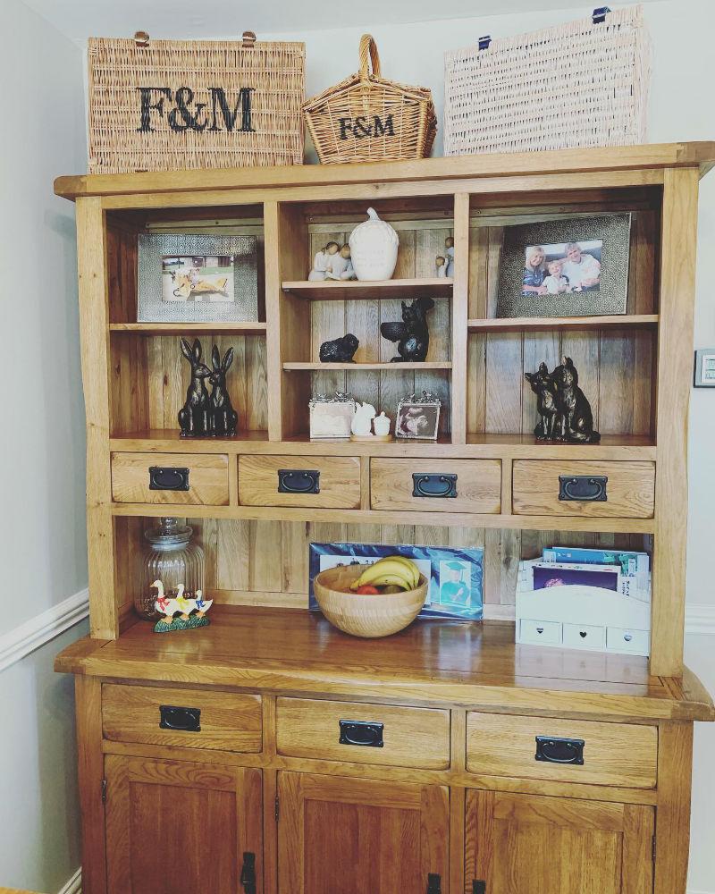 oak welsh dresser with wicker baskets