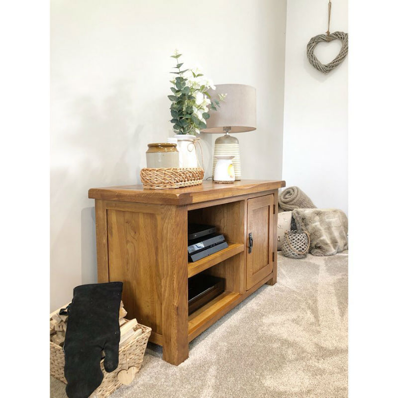 oak sideboard with neutral accessories