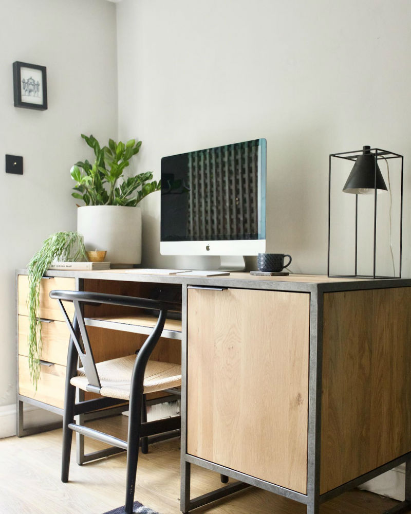 industrial style computer desk in modern office
