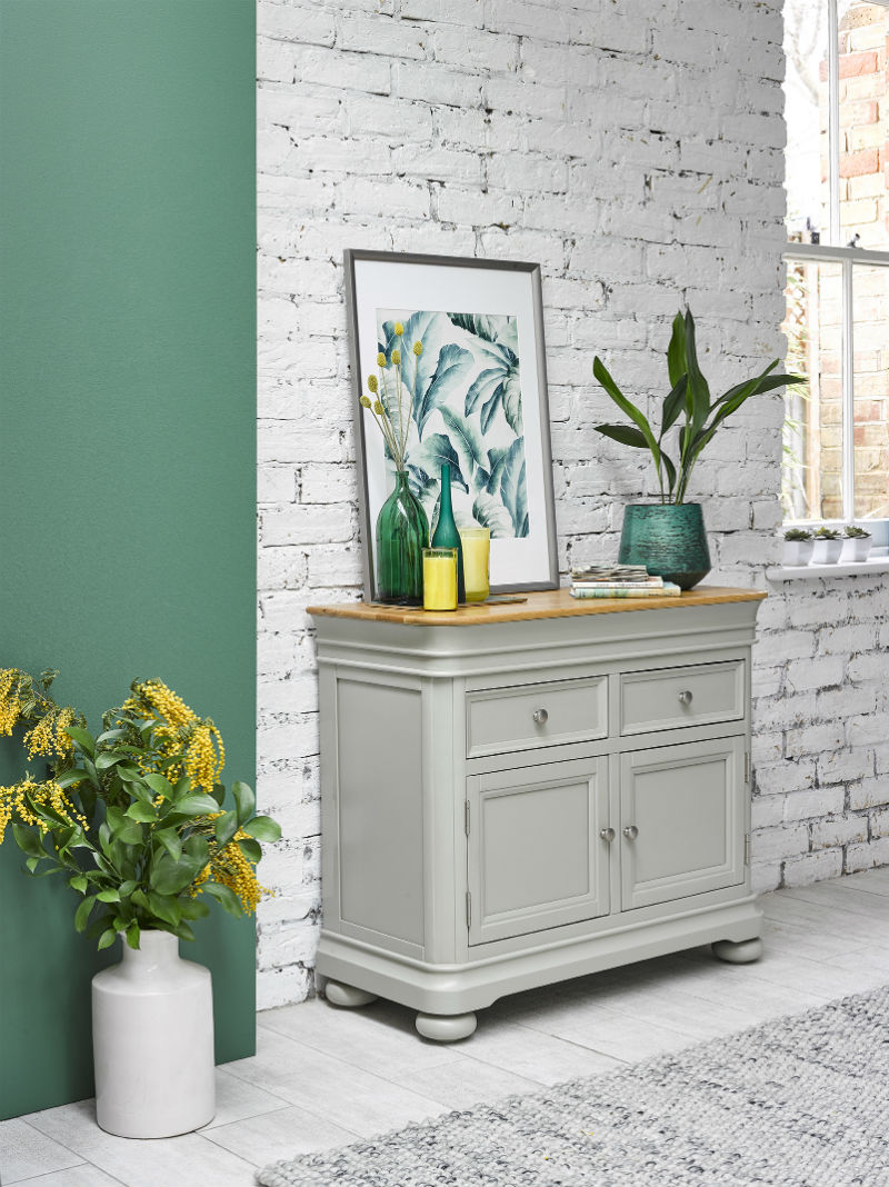 sage green painted sideboard in urban kitchen