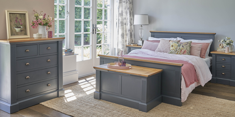 Traditional blue matching bedroom furniture in bright bedroom