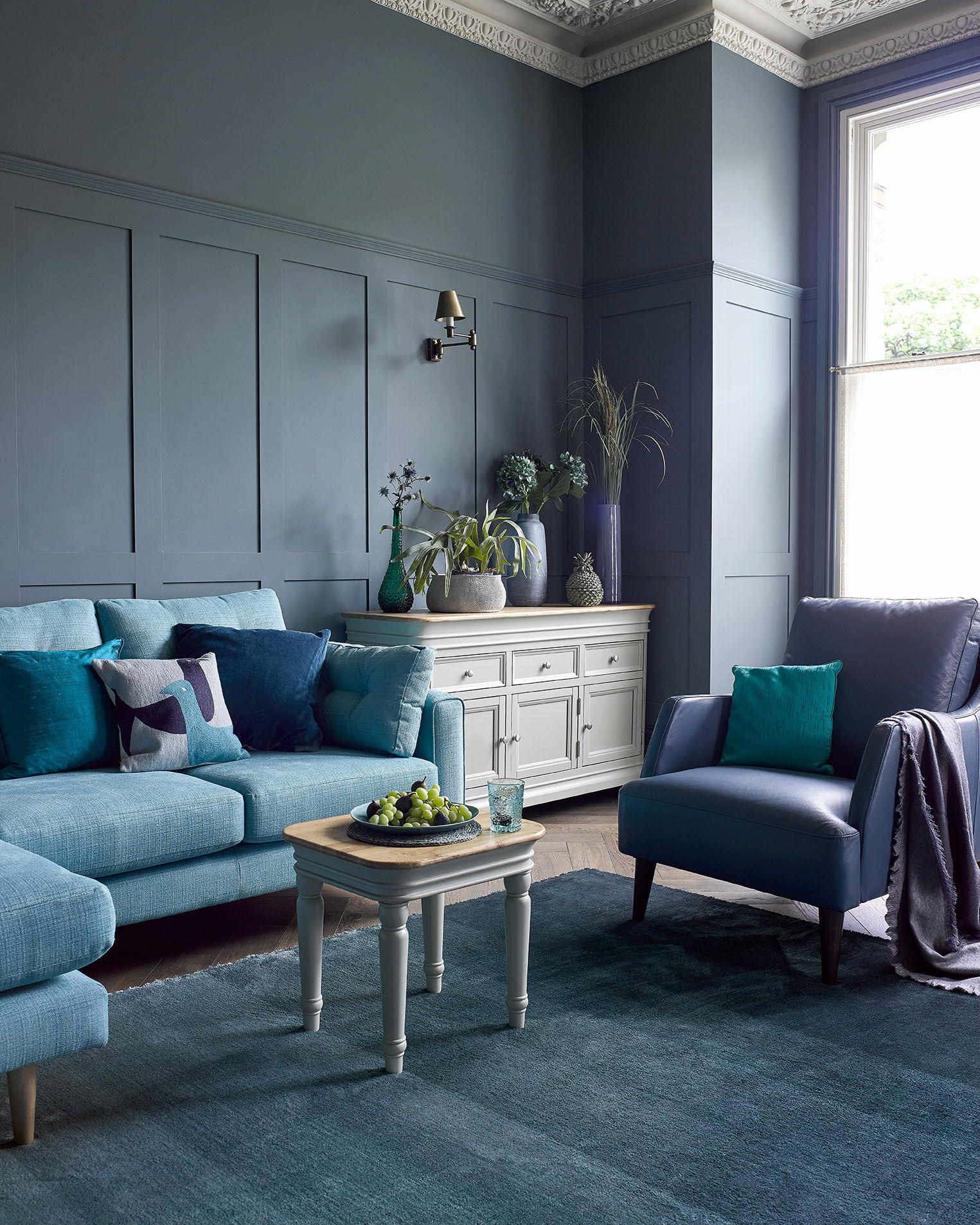 Blue themed living room with grey painted furniture