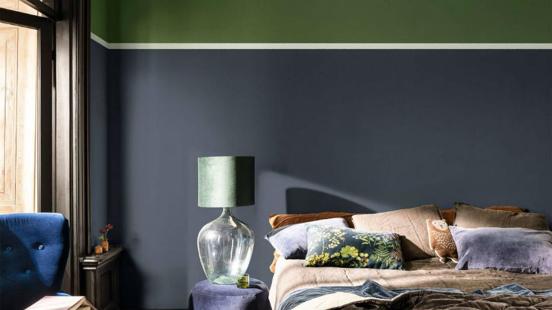 grey and green themed bedroom with blue accessories