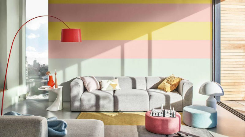 living room with multicoloured striped feature wall