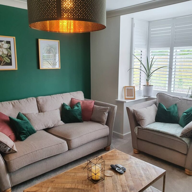 Green feature wall living room