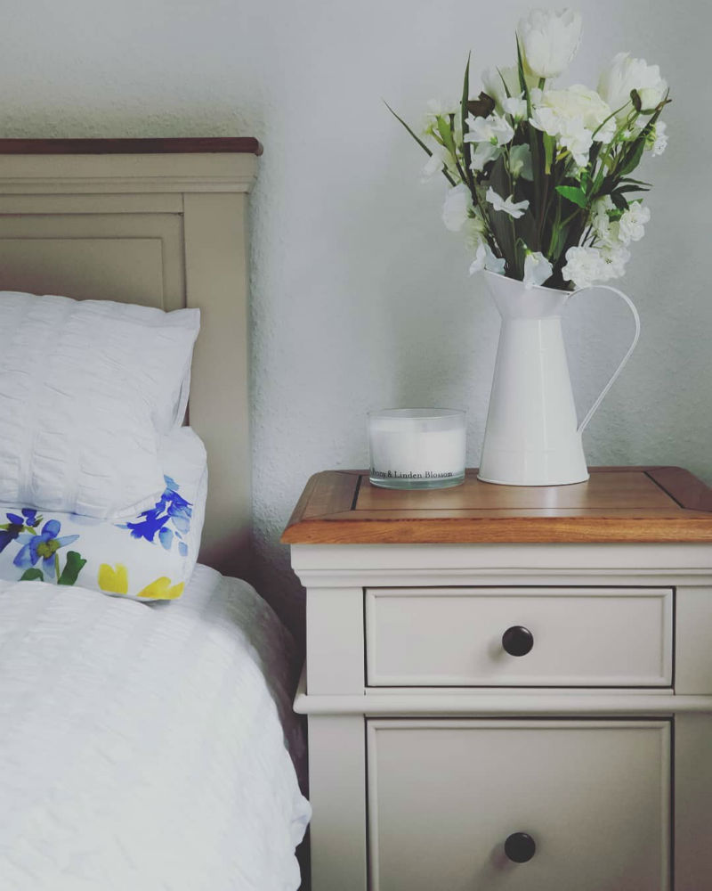 white painted bed and matching bedside table