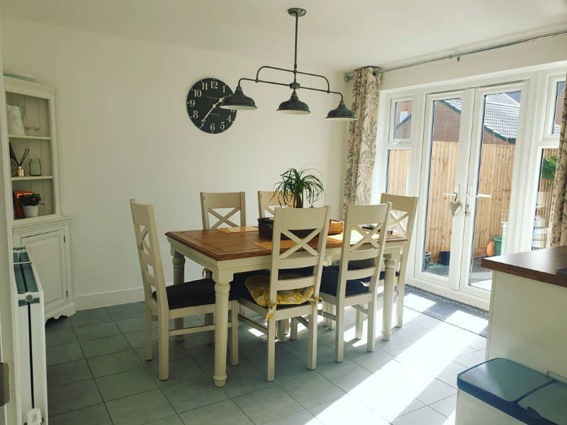 white painted dining set in open plan kitchen diner