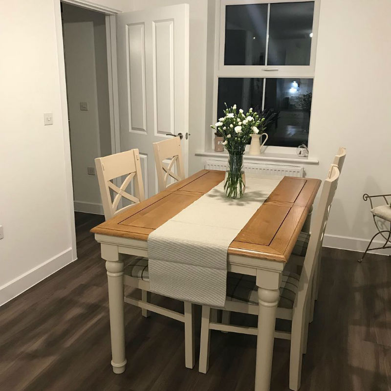 white and oak dining table with matching chairs