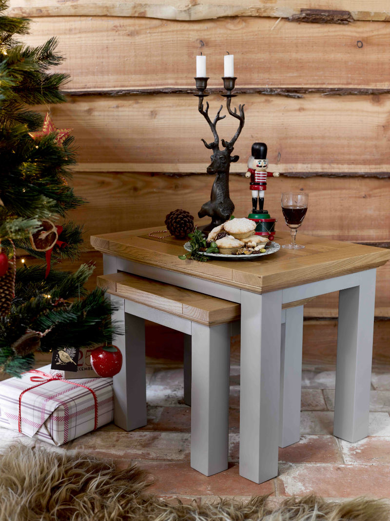Nest of grey-painted tables with natural oak top in Christmas scene