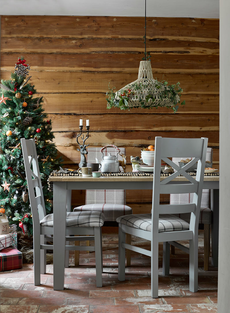 grey painted dining set in christmas themed kitchen