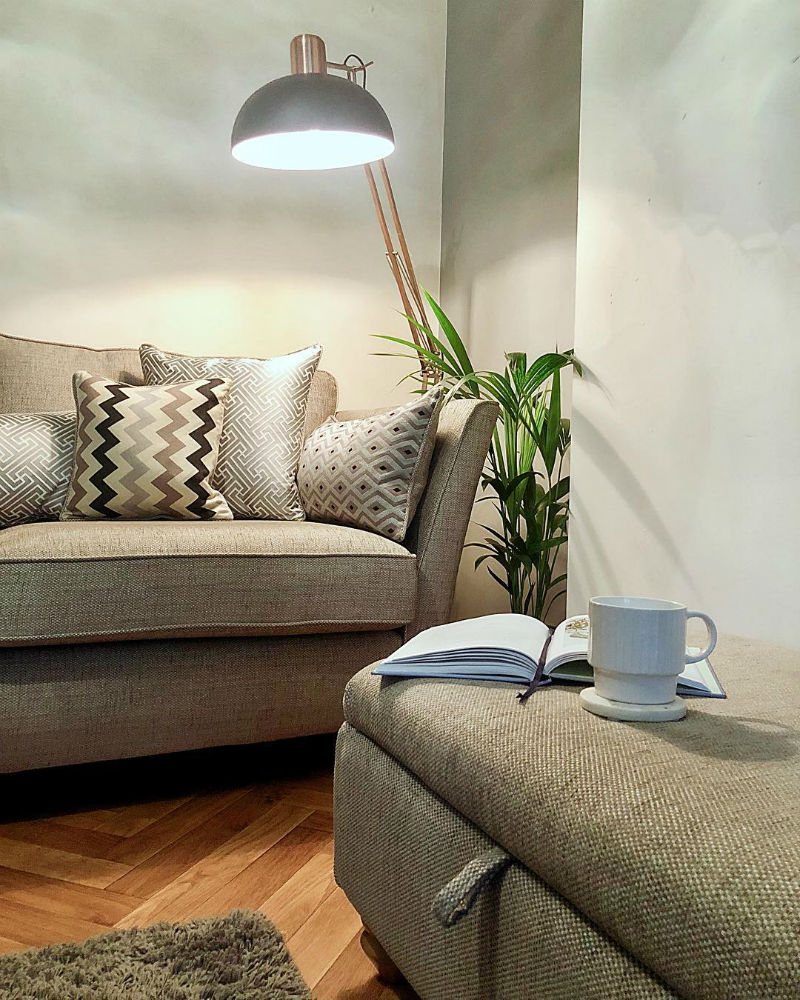 Silver traditional sofa with matching footstool