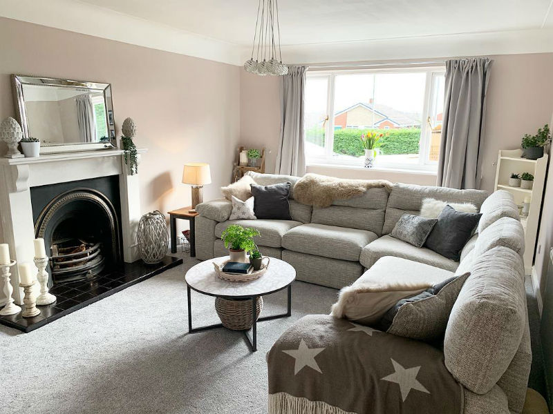 Grey modular corner sofa in neutral living room