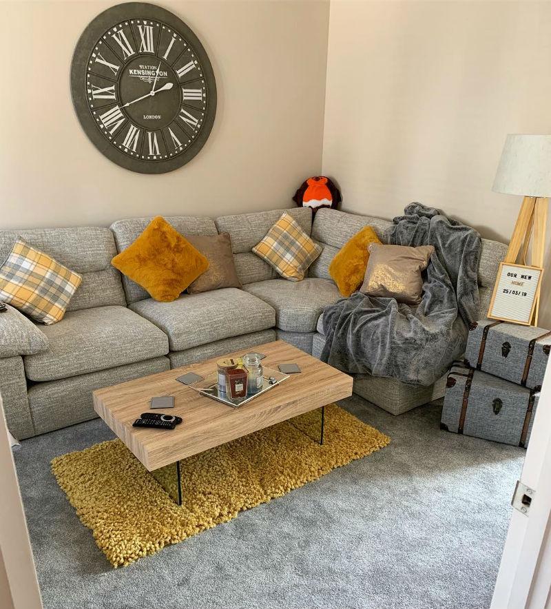 grey modular sofa with mustard accents